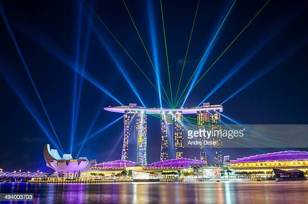 Award winning image of the Marina Bay Sands and Museum Laser light show with beams illuminating at the same time in Singapore.