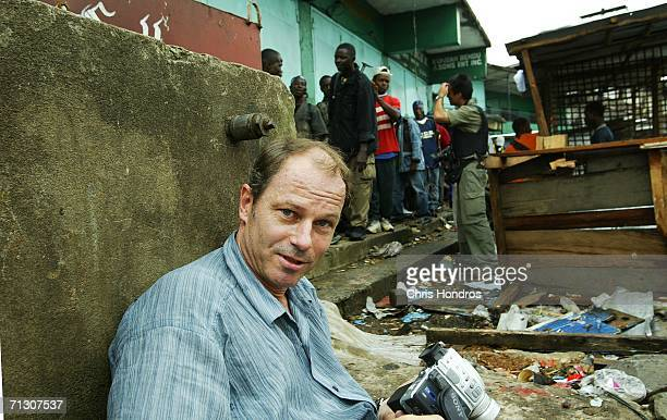 Award winning Swedish photojournalist Martin Adler sits among Liberian government soldiers during the rebel offensive on the city July 23 2003 in...