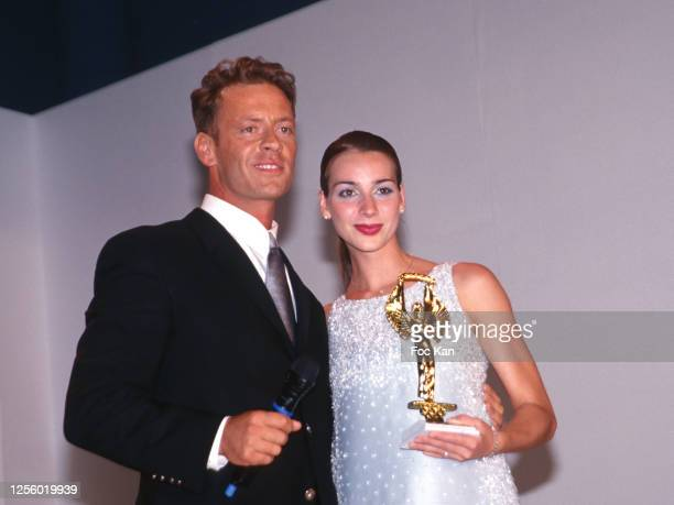 Awarded actor Rocco Siffredi and his wife Rosa Caracciolo attend Les Hot D'or during the 52nd Cannes Film Festival in May 1999, in Cannes, France.