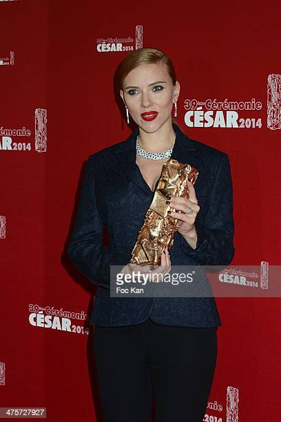 Awarded actress Scarlett Johansson poses with her Cesar in the awards room during the 39th Cesar Film Awards 2014 at Theatre du Chatelet on February...