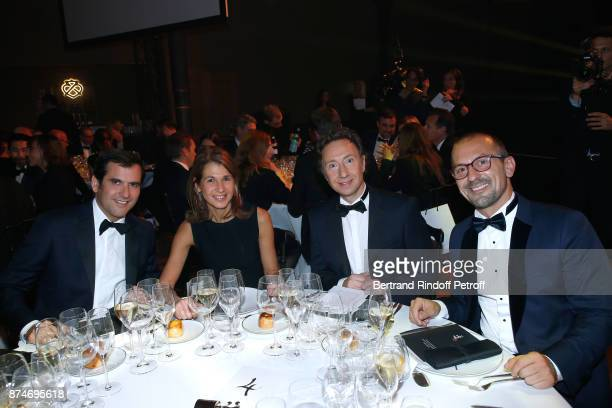 Awarded as Businessman of the year Nicolas Houze his wife AnneCharlotte Stephane Bern and Lionel Bounoua attends the GQ Men of the Year Awards 2017...