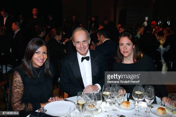 Awarded as Political Womman of the year Mayor of Paris Anne Hidalgo CEO of Condenast France Xavier Romatet and AnneCharlotte Houze attend the GQ Men...