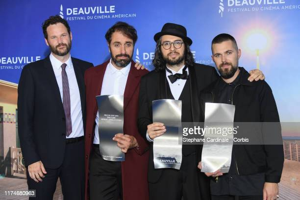 US awarded Directors Kyle Marvin Michael Angelo Covino Carlo Mirabella Davis and Robert Eggers pose with their prices during the Jury Award Winners...