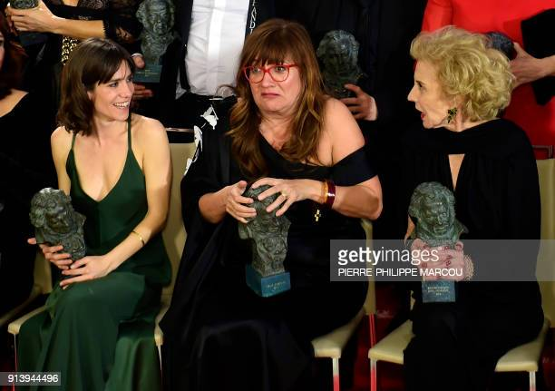 Awarded Spanish film director Isabel Coixet gestures between also winners actresses Marisa Paredes and Bruna Cusi at the 31st Goya awards ceremony in...