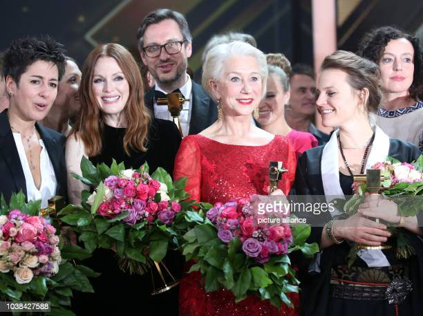 Awardees Dunja Hayali Julianne Moore Helen Mirren and Maria Simon pose on stage after the 51st GoldenCamera Award in Hamburg Germany 6 February 2016...