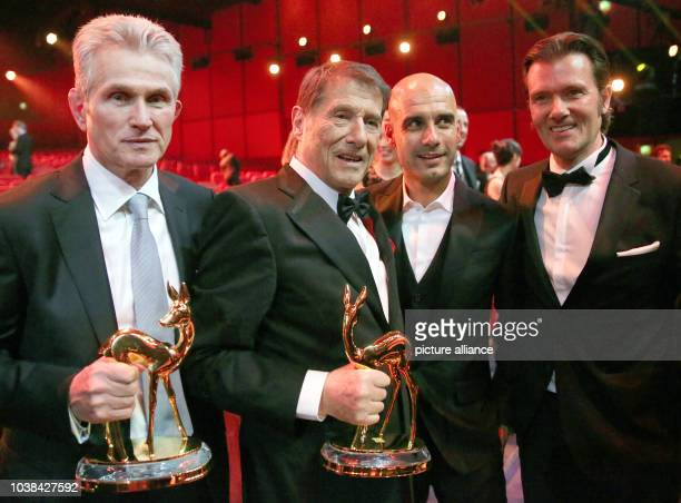 Awardees Udo Juergens and Jupp Heynckes pose with their Bambi awards next to FC Bayern Munich coach Pep Guardiola and Juergen's son John Juergens at...