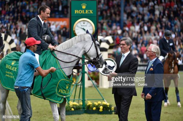 awards ceremony the winner Gregory Wathelet of Belgium riding Coree Horse is mirrored in its award during Rolex Grand Prix CHIO World Equestrian...
