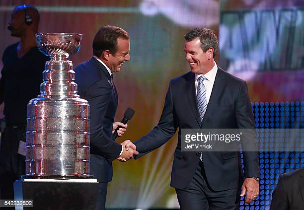 Awards host Will Arnett left shakes hands with head coach Mike Sullivan of the Pittsburgh Penguins during the 2016 NHL Awards at the Hard Rock Hotel...