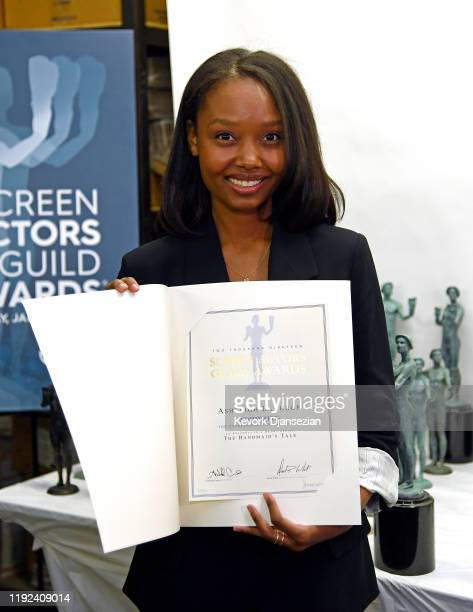 Awards Nominee Ashleigh LaThrop for The Handmaid's Tale poses with her nomineation certificate during pouring of the Screen Actors Guild Award...