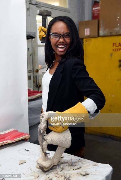 Awards Nominee Ashleigh LaThrop for The Handmaid's Tale prepares to break the cast on a Screen Actors Guild Award statuette in preparation of the...