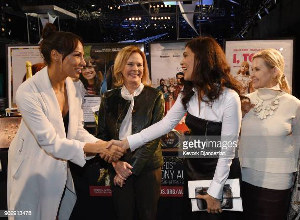 Awards nominees Amanda Brugel and Laura Gomez greet each other with SAG Awards Committee Chair SAFAFTRA Foundation President JoBeth Williams and...