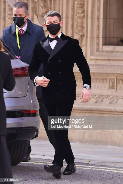 Awards Presenter Nick Jonas seen arriving at the EE British Academy Film Awards 2021 at the Royal Albert Hall on April 11, 2021 in London, England.