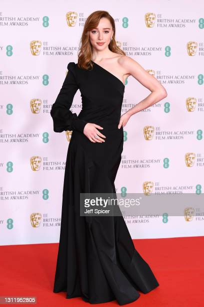 Awards Presenter Phoebe Dynevor attends the EE British Academy Film Awards 2021 at the Royal Albert Hall on April 11, 2021 in London, England.