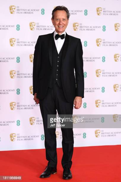 Awards Presenter Richard E. Grant attends the EE British Academy Film Awards 2021 at the Royal Albert Hall on April 11, 2021 in London, England.