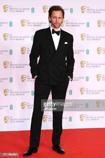Awards Presenter Tom Hiddleston attends the EE British Academy Film Awards 2021 at the Royal Albert Hall on April 11, 2021 in London, England.