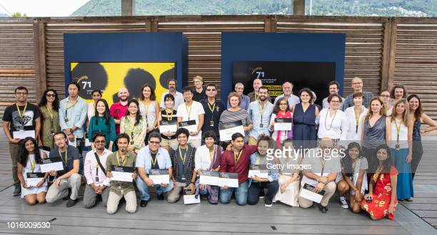 Awards winners and staff pose at the Open Doors Award Ceremony during the 71st Locarno Film Festival on August 7 2018 in Locarno Switzerland