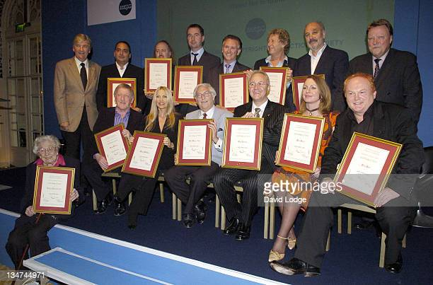 Awards winners including Evelyn Barbirolli OBE , Lynsey De Paul , Sam Brown and Mike Batt . Back row, Bill Bailey and Tony Christie .