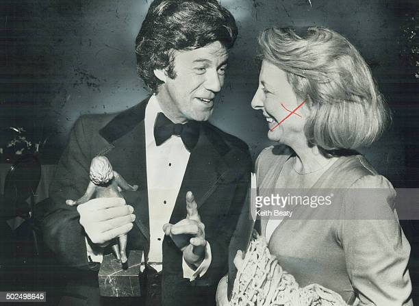 Awardwinning actor Gordon Pinsent and his wife Charmion happily share the moment of victory as he holds Earle Grey Award given to him for his...