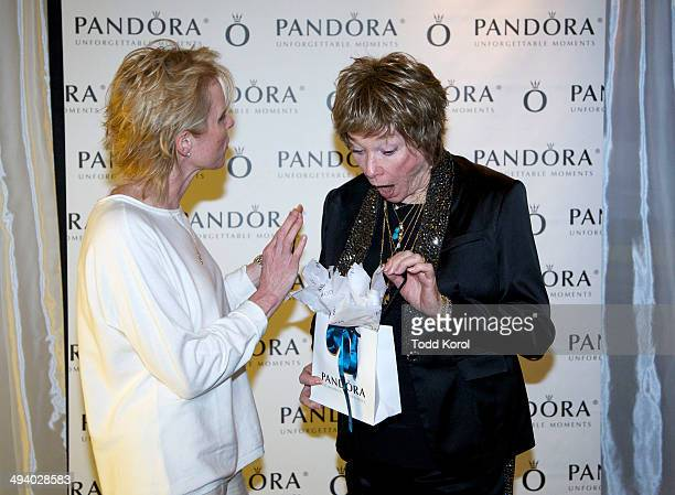 Awardwinning actress Shirley MacLaine is presented with a bracelet at the Unique Lives Experiences lecture series sponsored by PANDORA held at the...