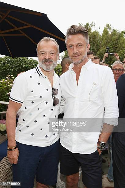 Award-winning comedian, Graham Norton and Hunt Beauchamp attend Daily Front Row's Boys of Summer party on July 9, 2016 in Water Mill, New York.