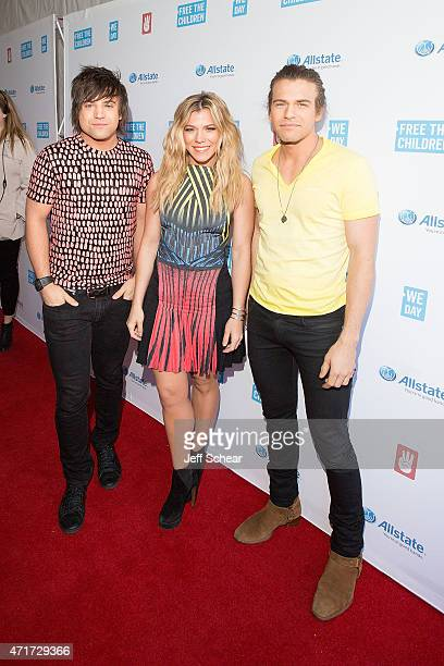 Awardwinning country music group Neil Perry Kimberly Perry and Reid Perry of The Band Perry walk the We Day Red Carpet at We Day Illinois 2015 at...