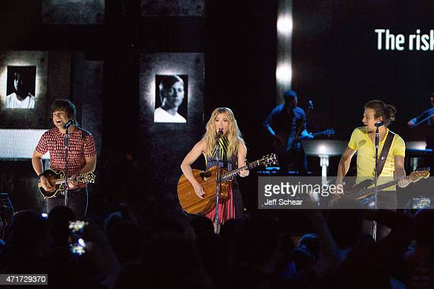 Awardwinning country music group Neil Perry Kimberly Perry and Reid Perry of The Band Perry perform for 15000 students at the inaugural We Day...