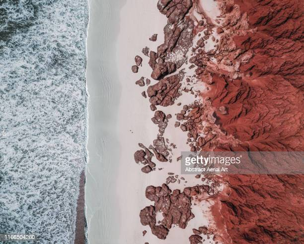 awe inspiring rock formations photographed by drone, james price point, western australia - aerial view stock pictures, royalty-free photos & images