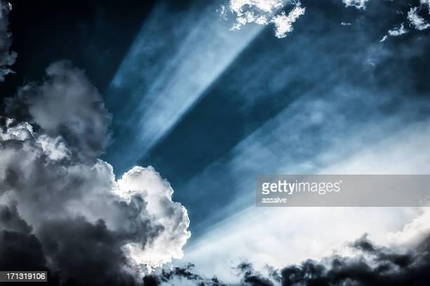 awe sunbeans shining through cloudscape