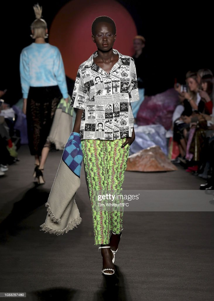 Aweng walks the runway at the Ashley Williams presentation during London Fashion Week September 2018 at the House of Vans on September 14, 2018 in London, England.