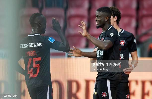 Awer Mabil and Mayron George of FC Midtjylland celebrate after scoring their third goal during the Danish Superliga match between FC Midtjylland and...