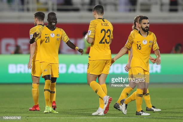 Awer Mabil celebrates with Tomas Rogic after scoring the opening goal during the AFC Asian Cup Group B match between Australia and Syria at Khalifa...