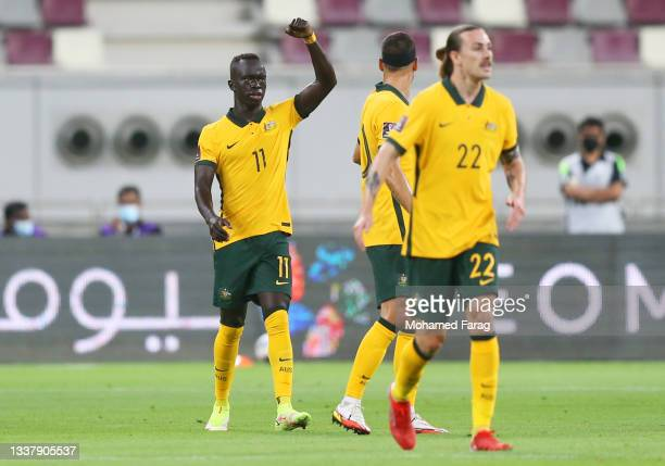 Awer Mabil of Australia celebrates with teammates after scoring their team's first goal during the 2022 FIFA World Cup Qualifier match between...
