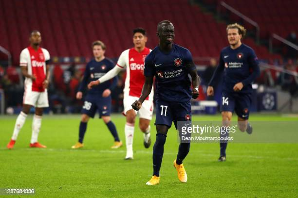 Awer Mabil of FC Midtjylland celebrates after scoring their team's first goal during the UEFA Champions League Group D stage match between Ajax...