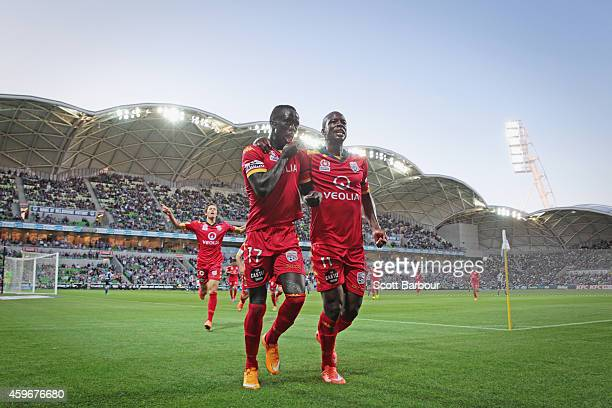 Awer Mabil of United is congratulated by Bruce Djite after scoring a goal during the round eight ALeague match between Melbourne Victory and Adelaide...
