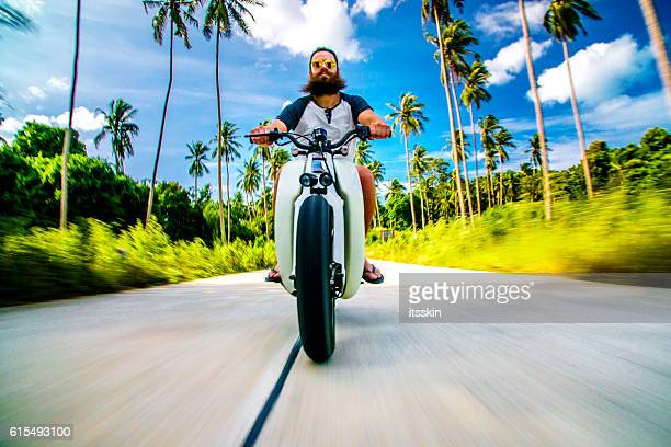 Awesome bearded guy riding his custom bike in Thailand