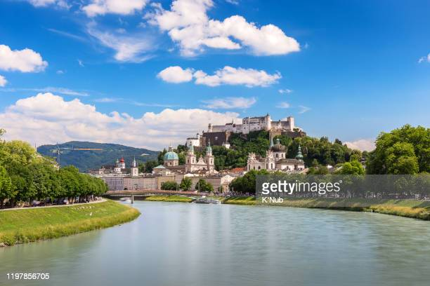 awesome, beautiful view of old town and the fortification castle or fortress hohensalzburg on the hill, salzburg austria, europe with clear blue sky - salzburger land stock pictures, royalty-free photos & images