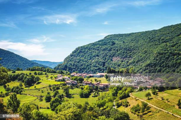 awesome landscape view of small old french village in circle shape in valley of bugey mountains in ain - auvergne rhône alpes stock pictures, royalty-free photos & images