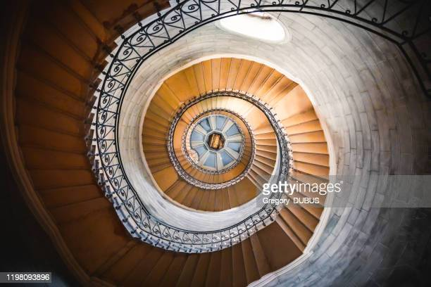 awesome large spiral staircase seen from below inside one of the beautiful bell towers of the basilica notre dame de fourviere in lyon french city - ceiling stock pictures, royalty-free photos & images