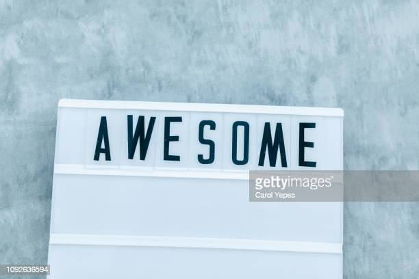 awesome message in lightbox.top view - single word stock pictures, royalty-free photos & images