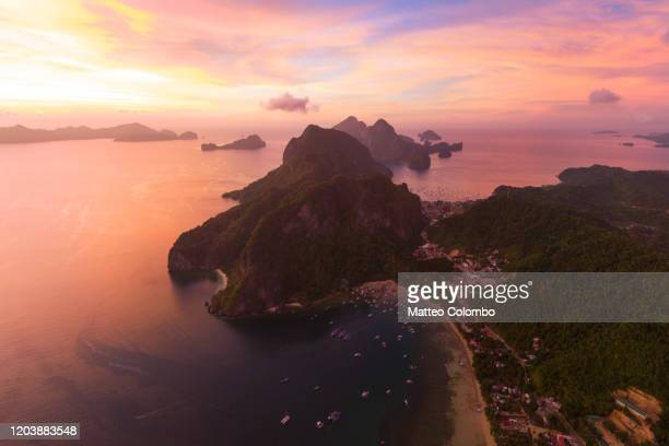 awesome sunset over el nido, palawan, philippines - palawan island stock pictures, royalty-free photos & images