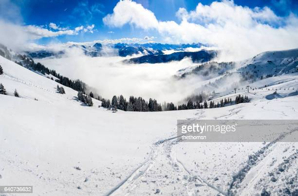 awesome view and tracks in the snow, alps, austria - kitzbühel stock pictures, royalty-free photos & images