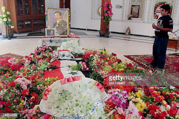 An Iraqi boy prays next to the tomb of executed former Iraqi president Saddam Hussein in the northern Iraqi village of Awja 28 April 2007 In another...