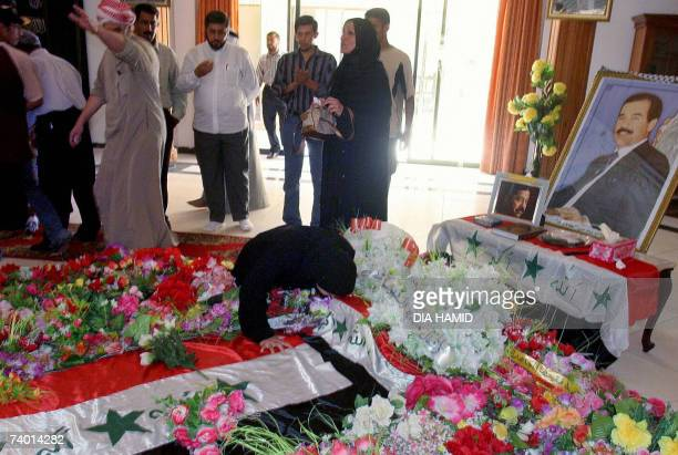 An Iraqi woman kisses the tomb of executed former Iraqi President Saddam Hussein in the northern Iraqi village of Awja 28 April 2007 In another...