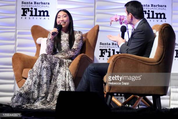 Awkwafina and Dave Karger speak onstage at the Virtuosos Award presentation during the 35th Santa Barbara International Film Festival at Arlington...