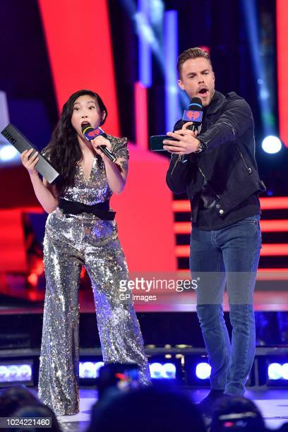 Awkwafina and Derek Hough at the 2018 iHeartRADIO MuchMusic Video Awards at MuchMusic HQ on August 26 2018 in Toronto Canada