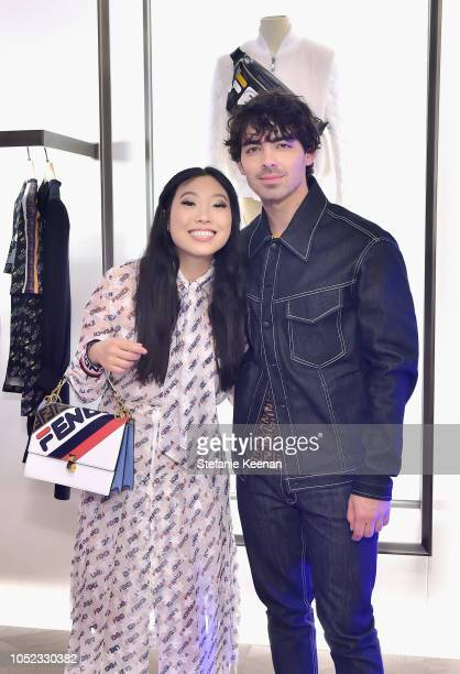 Awkwafina and Joe Jonas attend the FENDI MANIA Capsule Collection Launch Event at Fendi on October 16 2018 in Beverly Hills California