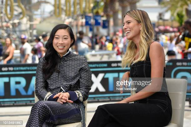 Awkwafina and Renee Bargh visit Extra at Universal Studios Hollywood on August 8 2018 in Universal City California