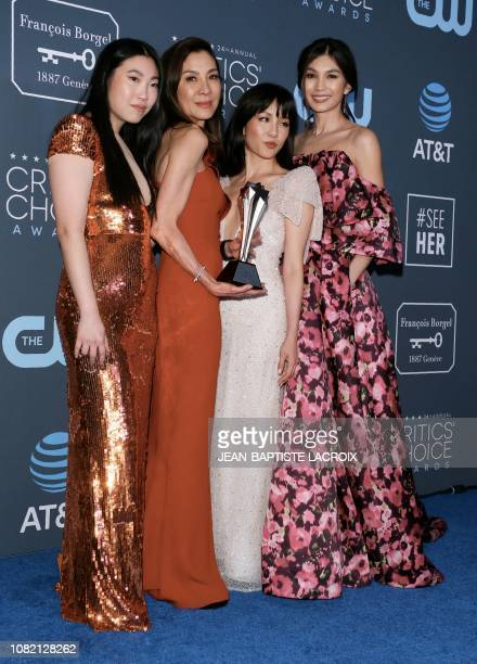 Awkwafina Michelle Yeoh Constance Wu and Gemma Chan poses in the press room holding the Best Comedy trophy for 'Crazy Rich Asians' during the 24th...