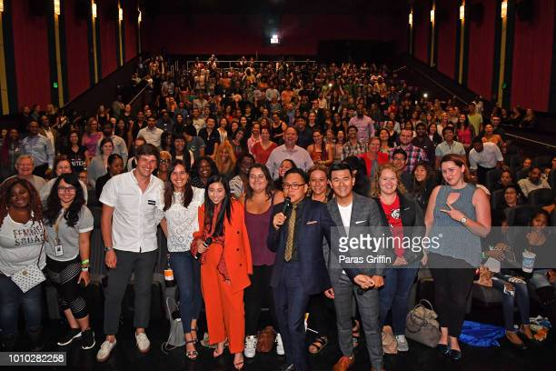 Awkwafina Nico Santos and Ronny Chieng pose with audience members during the Crazy Rich Asians Atlanta Red Carpet Screening at Regal Atlantic Station...