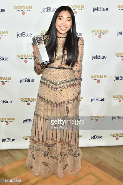 Awkwafina poses with an award backstage during the IFP's 29th Annual Gotham Independent Film Awards at Cipriani Wall Street on December 02, 2019 in...